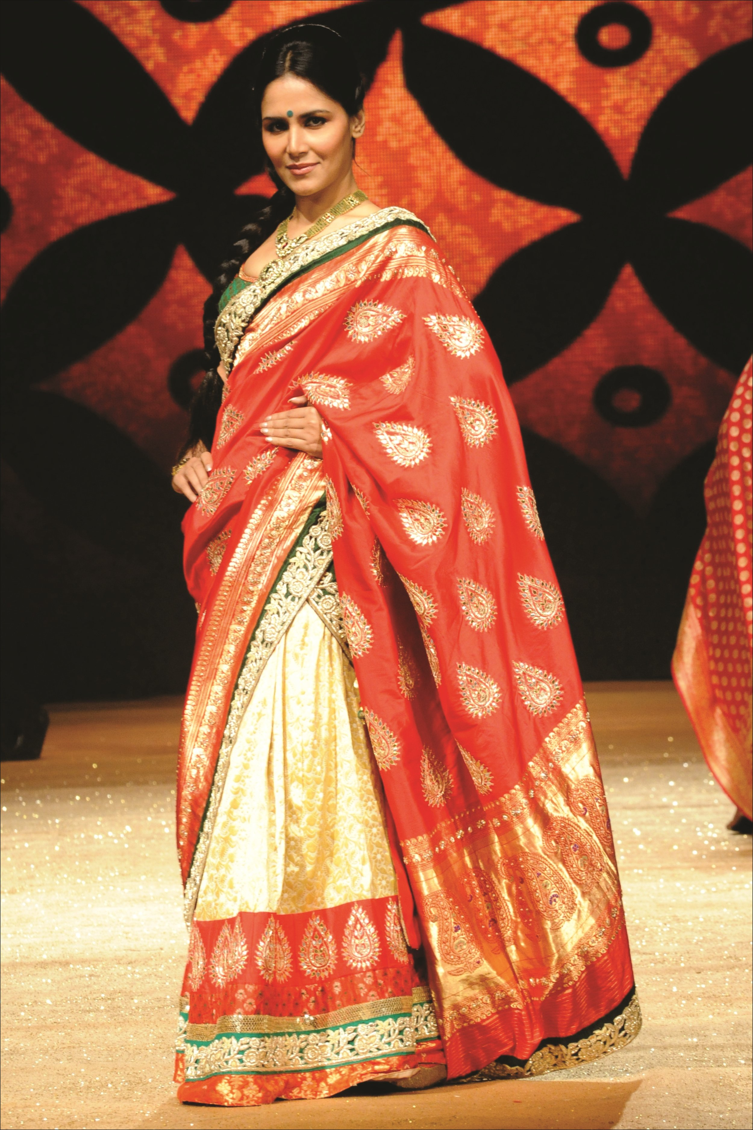 Lehnga Saree from Shyamal Bhumika in traditional red and gold colors
