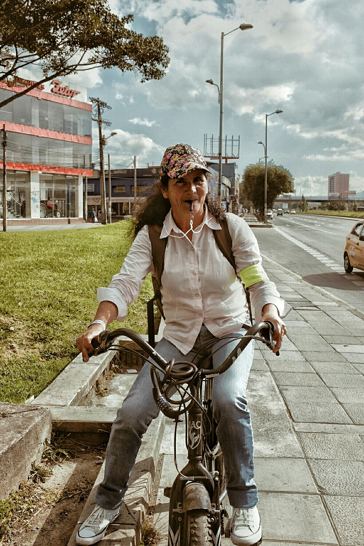 Local biker defending herself against taxis with a whistle.