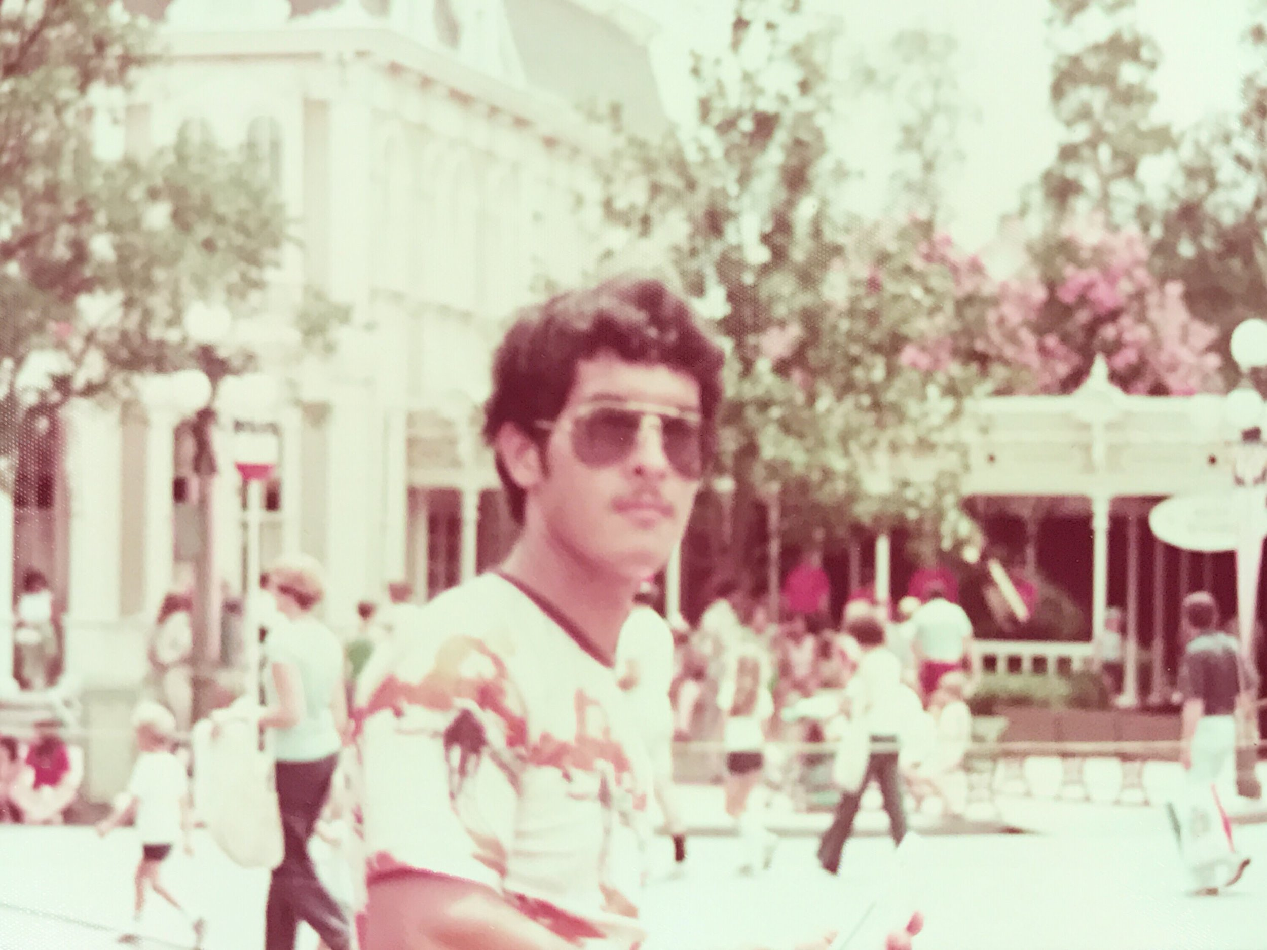 - My dad in his early twenties at the Magic Kingdom