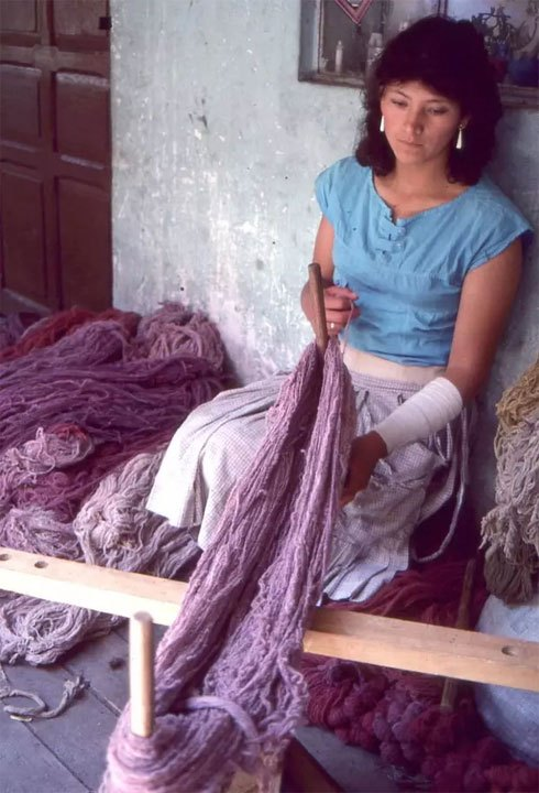 Edwin Sulca's wife twining yarns together that have been dyed with different shades of cochineal, 1986.