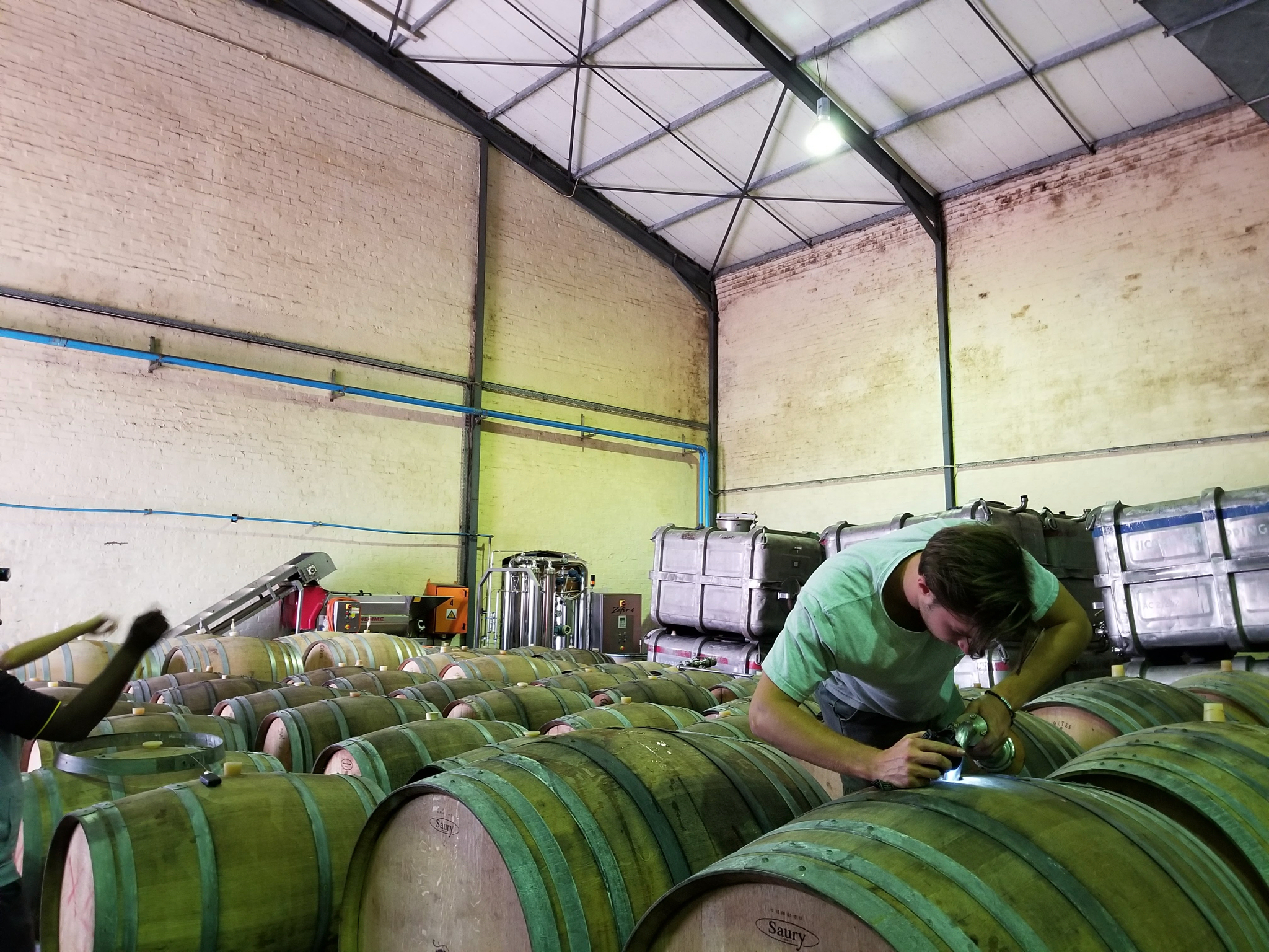 Walker Brown working on wine barrels