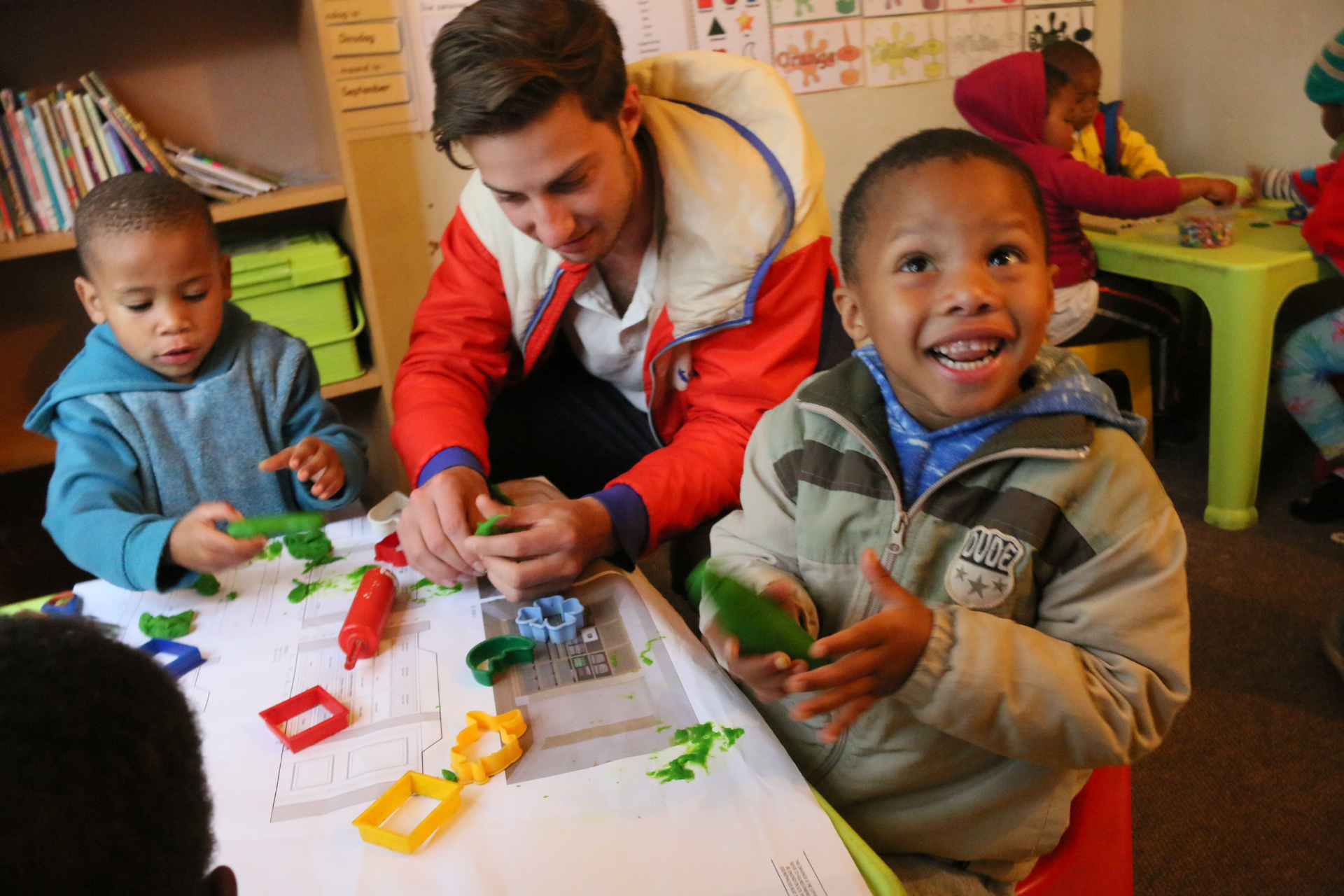 walker playing with kids at Pebbles Project Flenterskloof.JPG