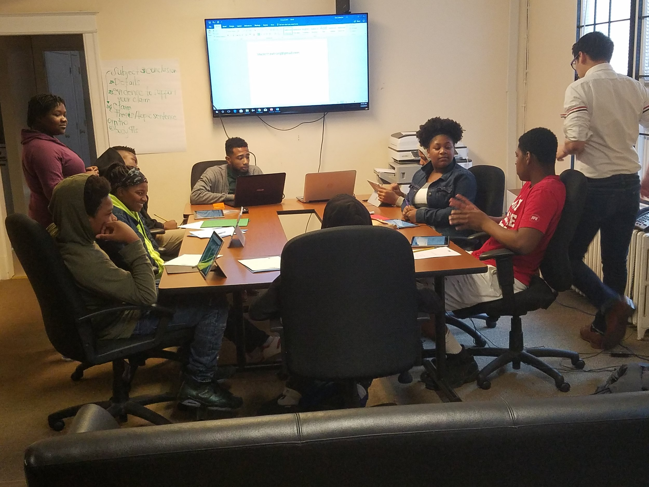 Code4Life participants working hard at the United Planning Organization, a long-time partner.