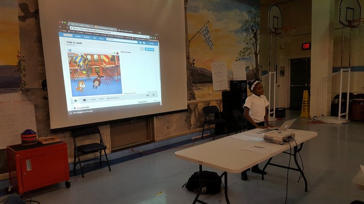 A students presenting her final project at Center City Congress Heights PCS.