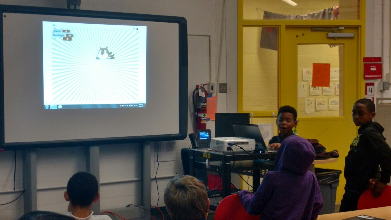 A team of Code4Life participants presents on their Scratch animation project.