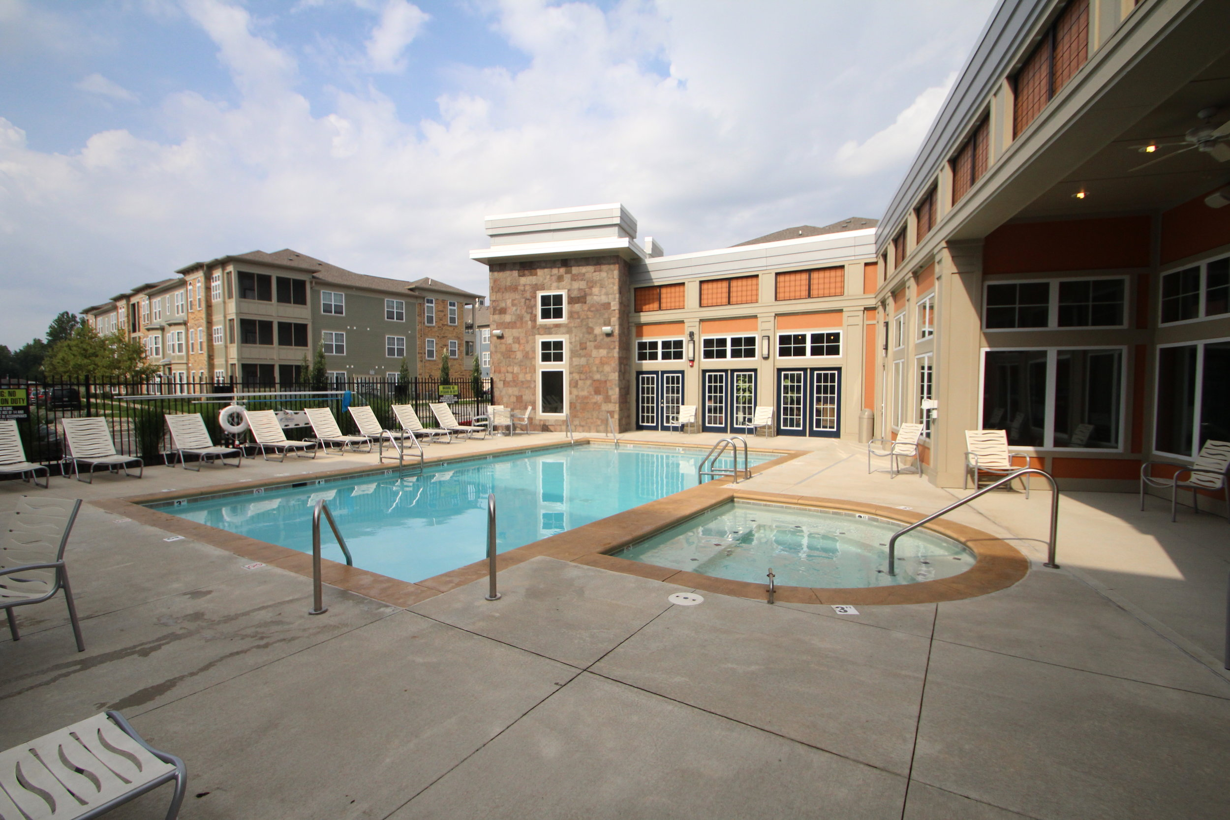 Apartments in Carmel One One Six pool with club house.JPG
