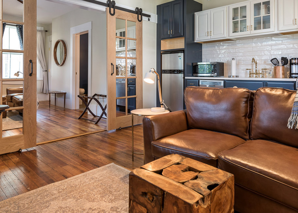 SOUTHERN LUXURY - A first-floor, rich-looking apartment in a modern style with blue, gold, and white finishes. Lots of character from the custom mirrored barn doors to the propeller style ceiling fans. Nice natural light fills the whole apartment in the morning.