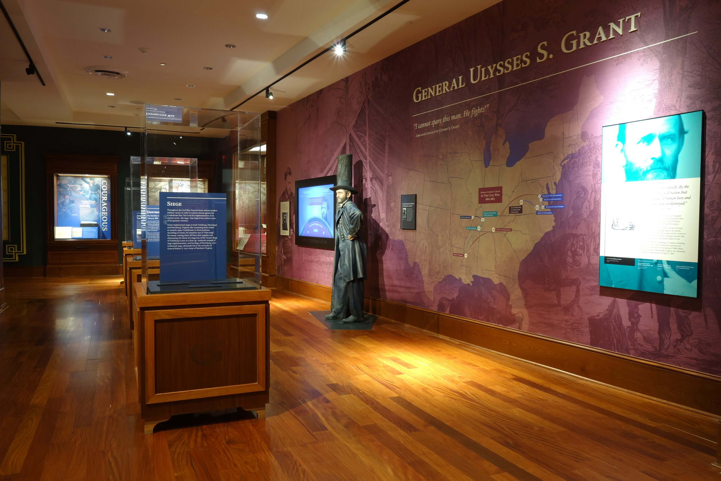 Extensive use of wall-murals as well as dimensional lettering and graphic panels brings depth and interest to the exhibit.