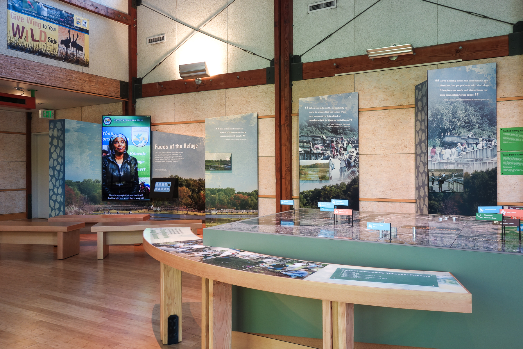 Sequential panels feature a landscape mural and stylized photos of visitors enjoying the refuge. An AV program elaborates on their stories.