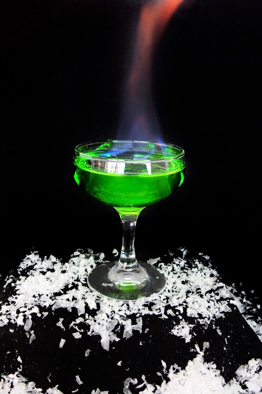 WILDFIRE - Wildfire is beautiful, but dangerous. The cocktail is beautiful, but delicious. A sweet combination of vodka and rum with some midori for colour, drink it in remembrance of the Battle of Blackwater Bay and the explosion of the Great Sept.