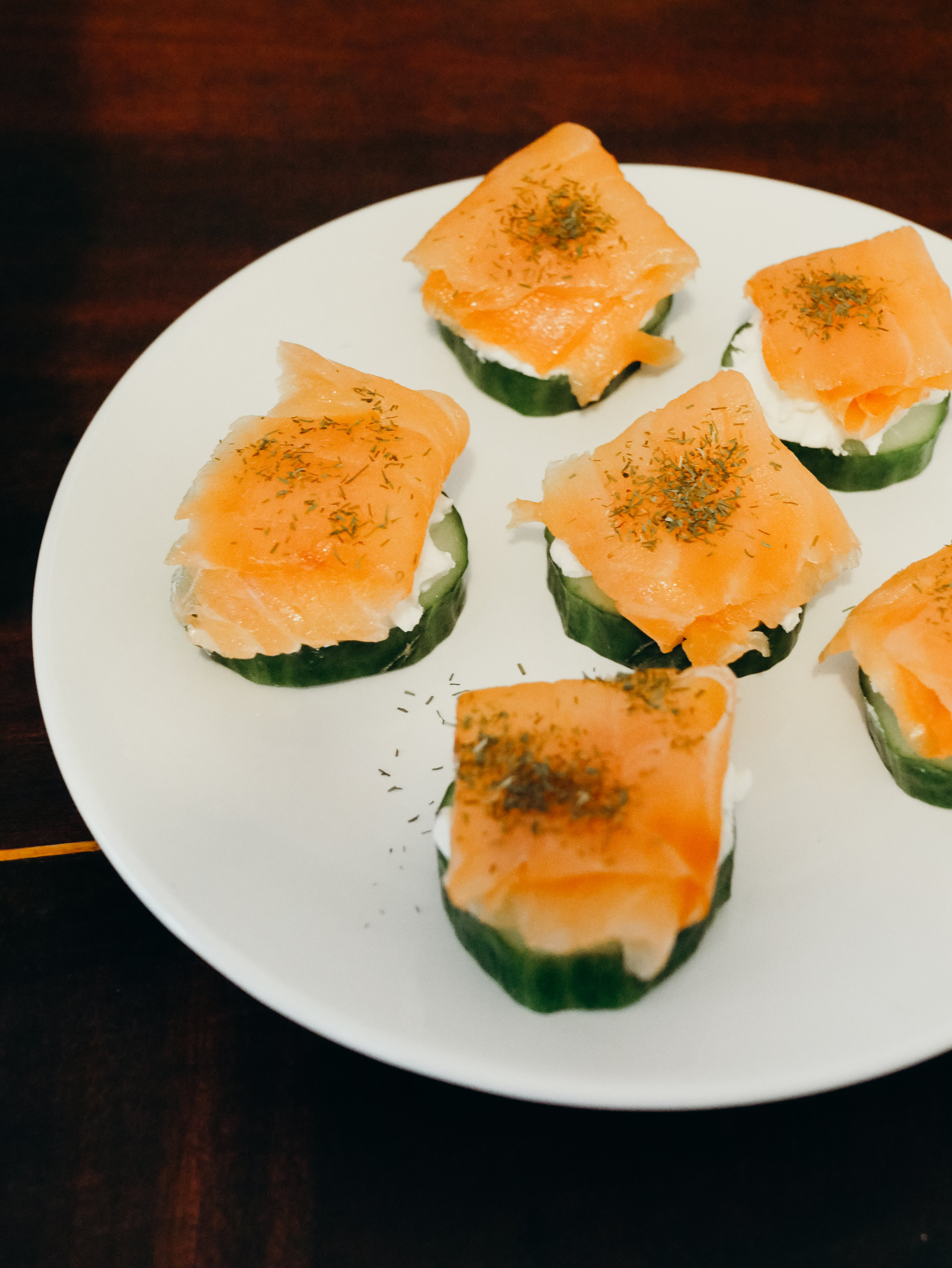 CUCUMBER SALMON ROUNDS - We didn't really follow a recipe for these either. We just sliced some cucumber, added a dollop of cream cheese (you could use another soft cheese with herbs or something), a sliver of smoked salmon, and dill.