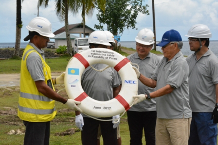 Richard Misech, of BSCC PMU, received the buoy from Surangel Sr. Mr Misech and the PMU on site team of Martin Blakely (wet) and Mike Gilbert (dry)