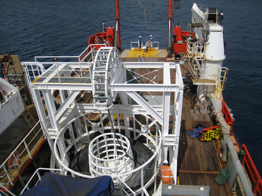 Cable lay operations on the vessel showing DA cable exiting the basket