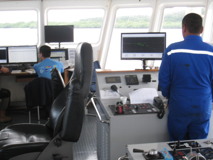 Captain at the aft DP helm maintaining vessel speed and position