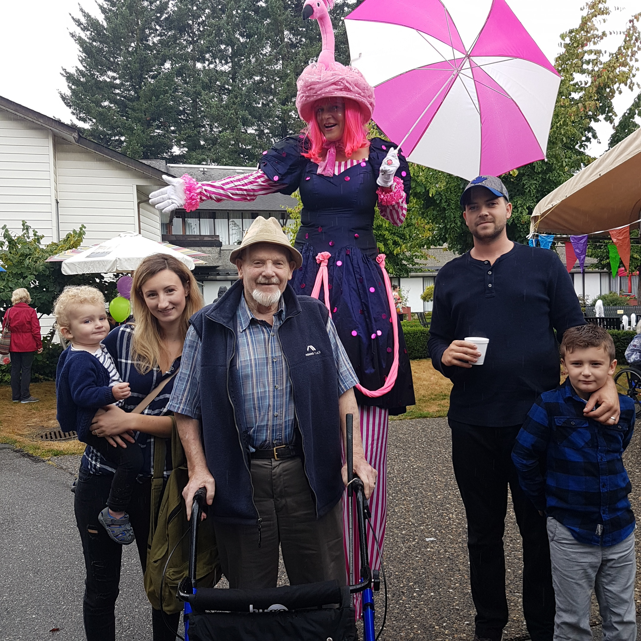 From the left – Dylan and his son, then the lady on stilts, next the one with the hat, me, and next to me the wife of Dylan, Natasha, with their youngest son on her arm. Their youngest son has curly blond hair, the kind my baldness should greatly improve with, however...