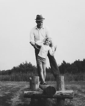 The author's grandfather, Luitje Smit, teaching her to balance.