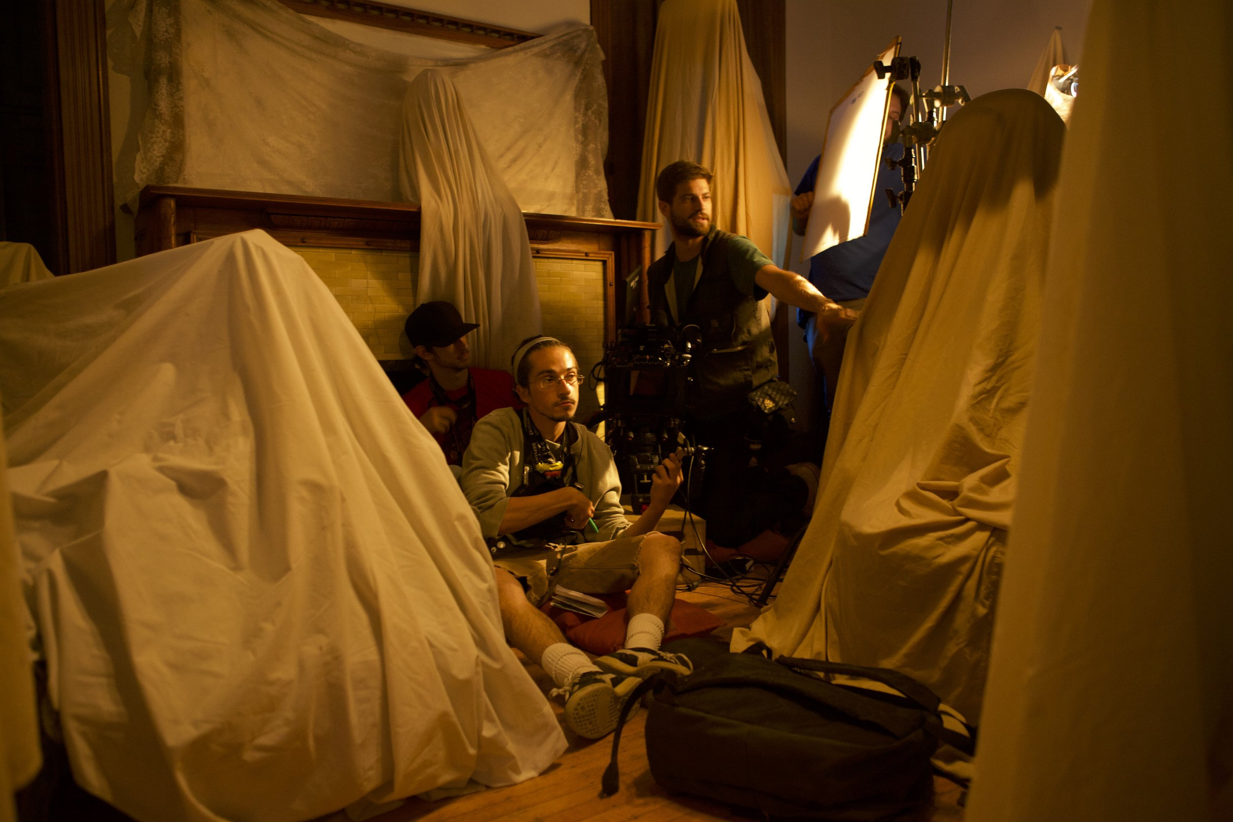Preparing a setup in the sheet-covered studio