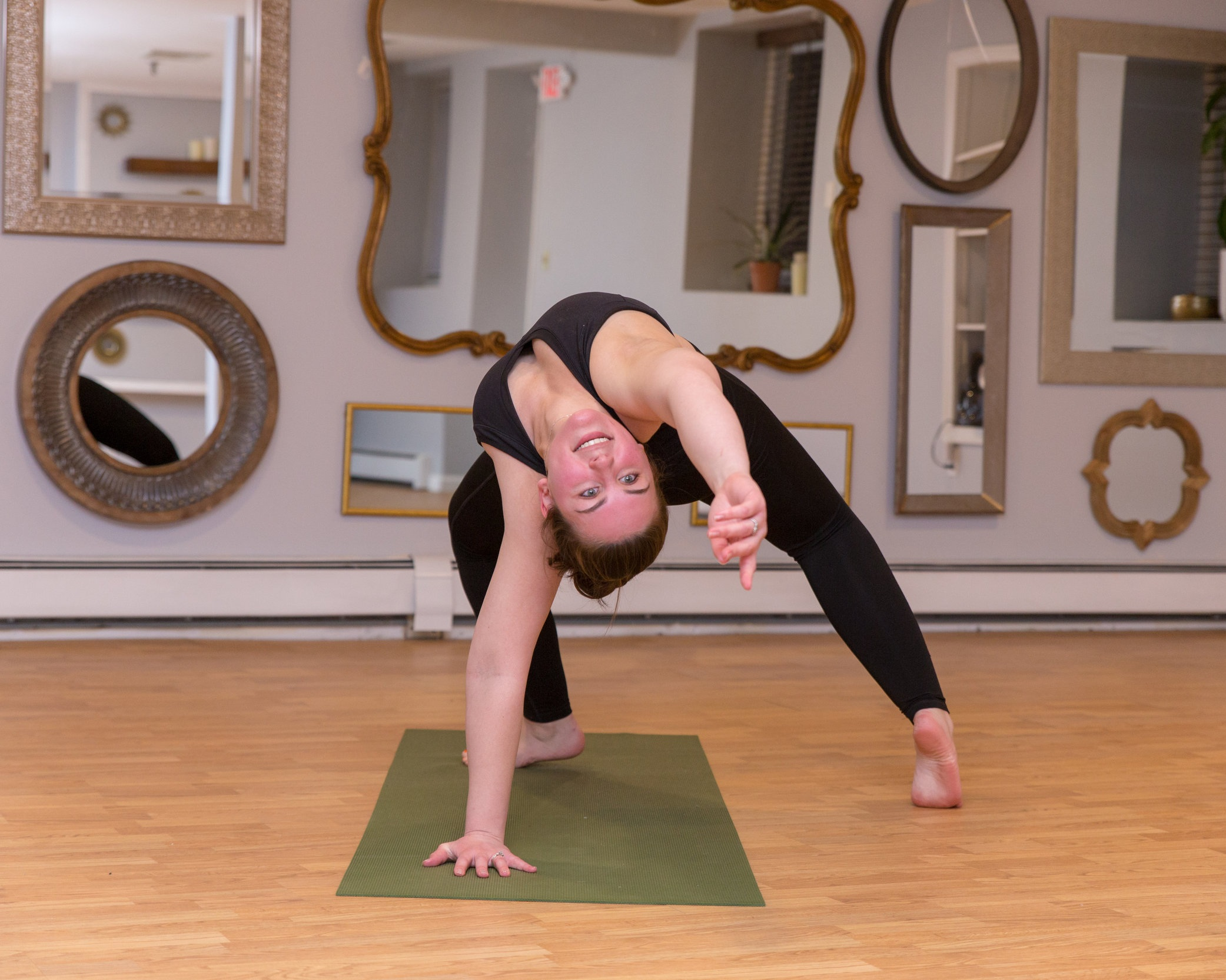 Riley Cammett  Riley Cammett began practicing yoga as a way to remain calm, focused, and in tune with herself. She has been practicing the physical asanas of yoga for the majority of her life but began to deepen her spiritual path of meditation and mindfulness for the past 3 years. Through the Vinyasa style, she began releasing her left over physical energy through the practice, as well as truly beginning to feel one with herself.  She has been trained in Vinyasa yoga since April of 2017. She achieved her RYT-200 from Prasada Yoga Center in North Hampton, NH and was trained by Dana Lincoln and Michelle Plante.  She studied Reiki under her Reiki Master Teacher, Jocelyn Boucher, the North Shore Medium, to enhance her spiritual practice and path. She received her Reiki 1 practitioner certificate in August of 2018. It is her hopes that by adding Reiki to her classes, she can create an atmosphere of physical asanas coupled with spirituality that leads to deepened experience in her class for all those to experience.  She is very open with her personal practice and bases her classes and personal sessions on not only what she feels her fellow yogis need physically, but she aims to calm the minds of her students while helping them to find their inner peace. She works with the form and alignment of her students, Pranayama - breathing techniques, as well as meditation and Reiki to intensify their experience. It is her goal to assist everyone that comes in her paths with finding their true divine by restoring their spiritual and physical process