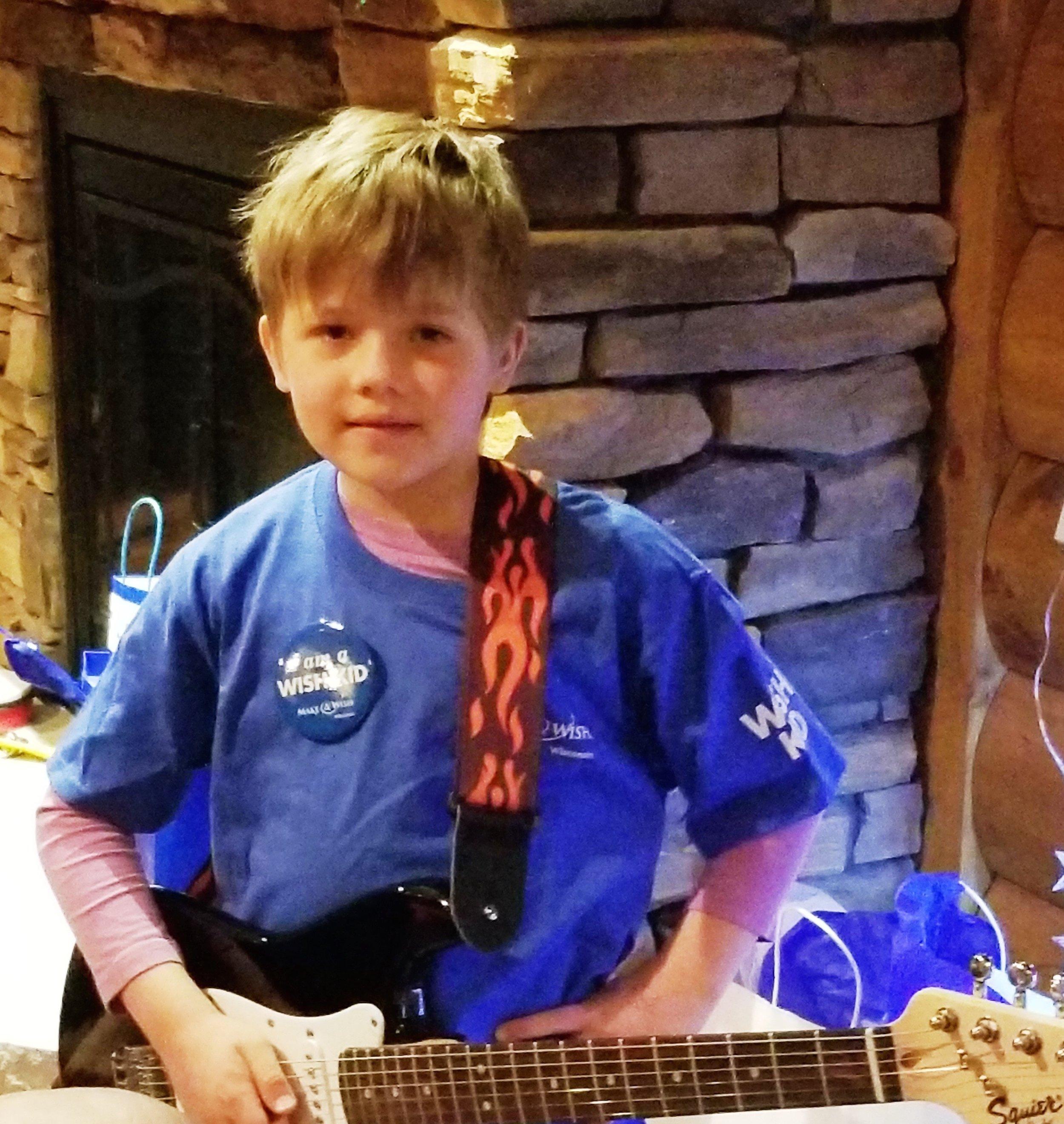 Wish recipient ilya with his new guitar.