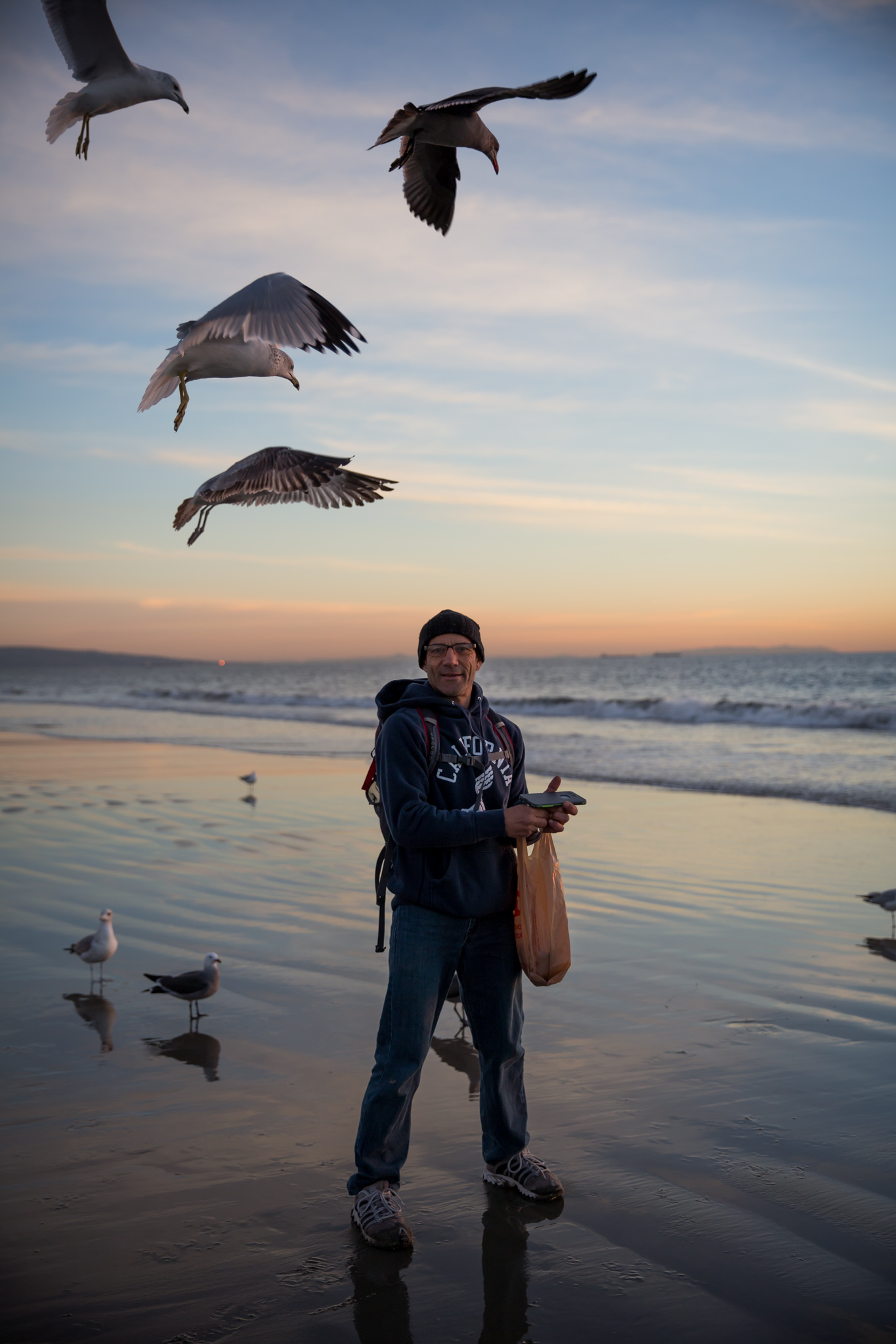 Venice local, Robert, feeds the seagulls at sunrise and sunset