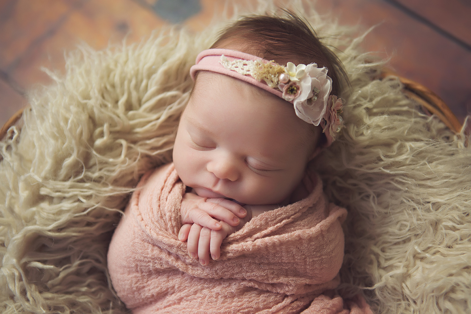 Newborn baby girl in a pink blanket