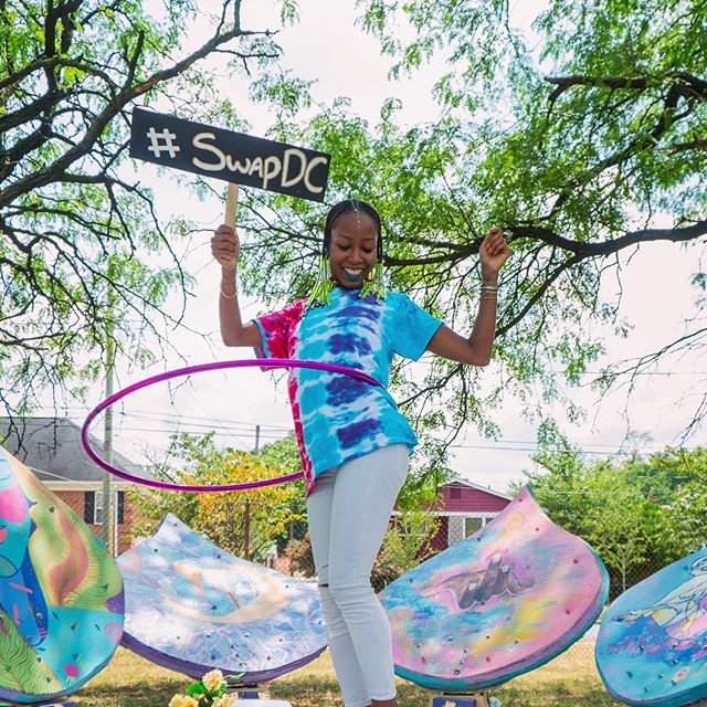 Our summer reset swap was great! 🌞🌞🌞🌞🌞🌞🌞🌞🌞🌞. And our back to school swap on September 21st at @marthastable will be even better! Mark your calendar 9/21. . . . Pictured is @zsameria at the wellness swap in the park, on the Lotus Womb created by @theomicollective murals by @maryamrassapour @daryanicc @hannah_atallah @monica.vercillo 💫 Check out their badass collective! Special thank you to @samiijoon for being magical that day!! #swapdc #markyourcalendar #swapmoredc #sustainablefashion #sustainability #thereisnoplanetb #communitybuilding #theomicollective #dc #dmv #dcswap #swapdcapproved #familyaffair #oneworld #creativerecycling #recycle #notyouraverageswap #dckids #fun #community #clothing #vintage #music #savetheearth #myDCcool #donate
