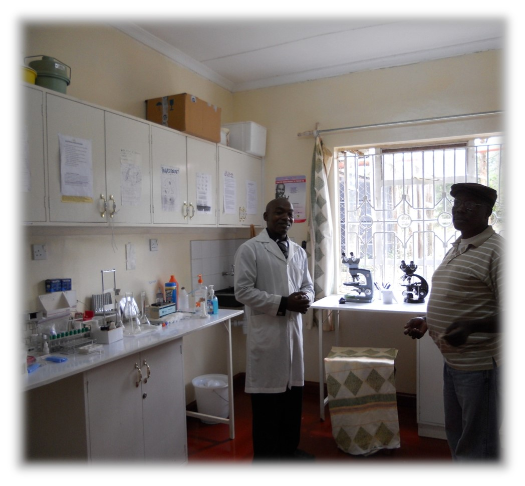 Muthoka with a lab tech in the Clinic Lab