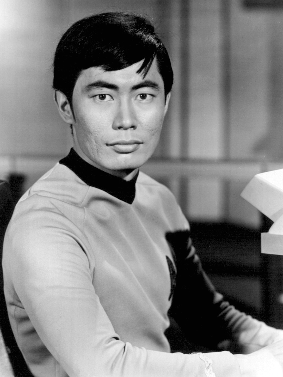 George Takei  as Lieutenant Hikaru Sulu, from  Star Trek  (1966) By NBC Television (eBay item photo front photo back) [Public domain], via Wikimedia Commons