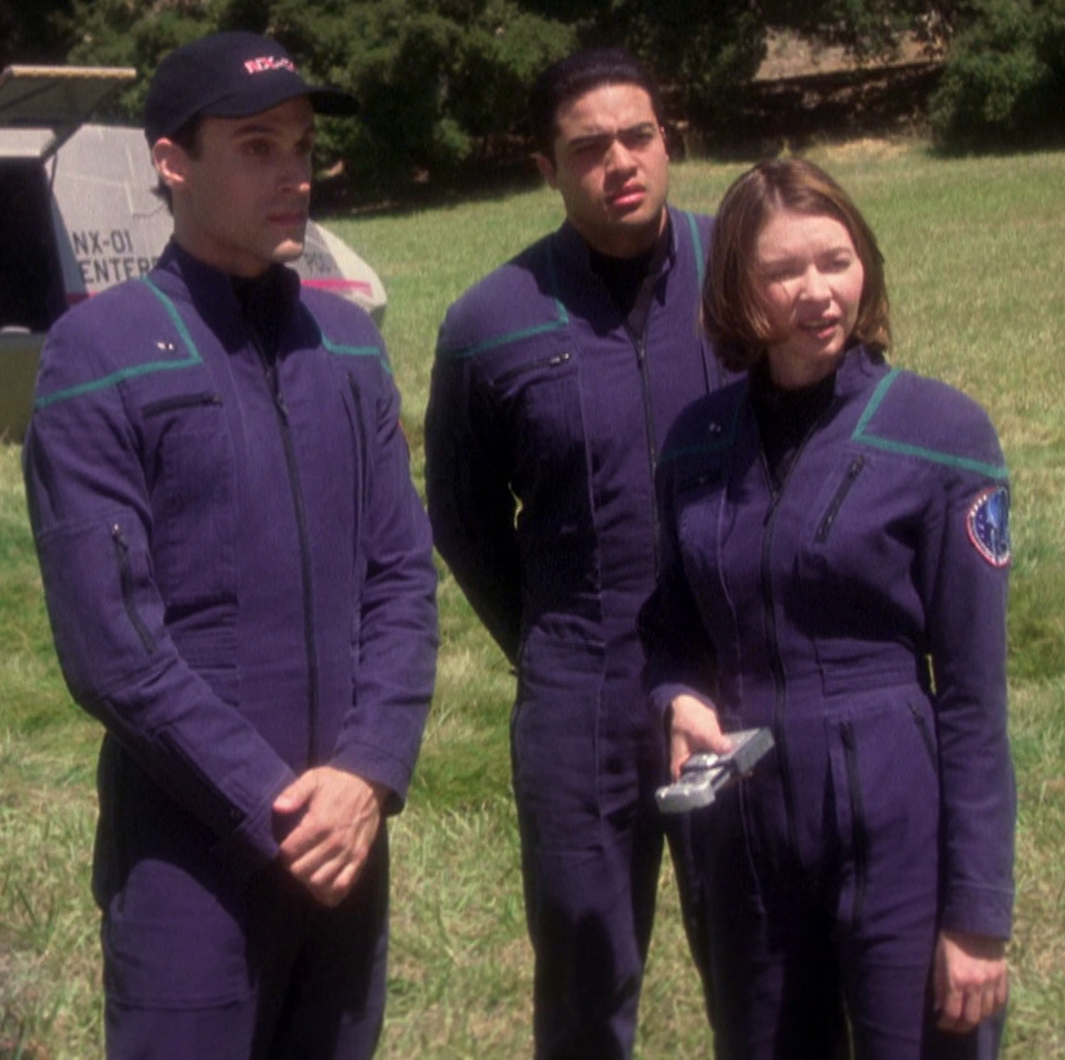 Science division uniforms, 2151  Fair Use - this image is copyrighted, but used here under  Fair Use guidelines. Owner/Creator:Paramount Pictures and/or CBS Studios  From left to right: Crewman Second Class Ethan Novakovich, unnamed science division crewman, and Crewman First Class Elizabeth Cutler  Retreived via http://memory-alpha.wikia.com