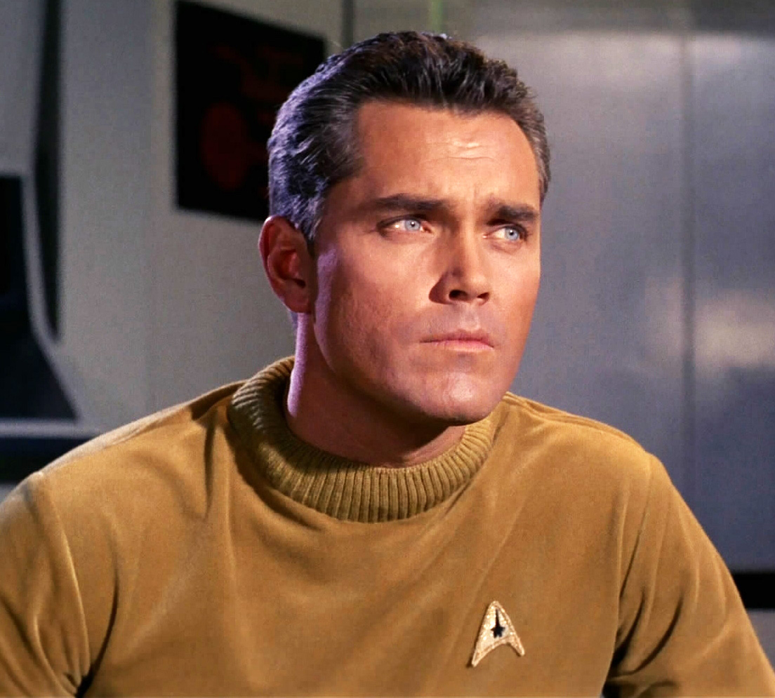 Command division uniform, male, 2254  Fair Use - this image is copyrighted, but used here under  Fair Use guidelines. Owner/Creator:Paramount Pictures and/or CBS Studios  Captain Christopher Pike  Retreived via http://memory-alpha.wikia.com