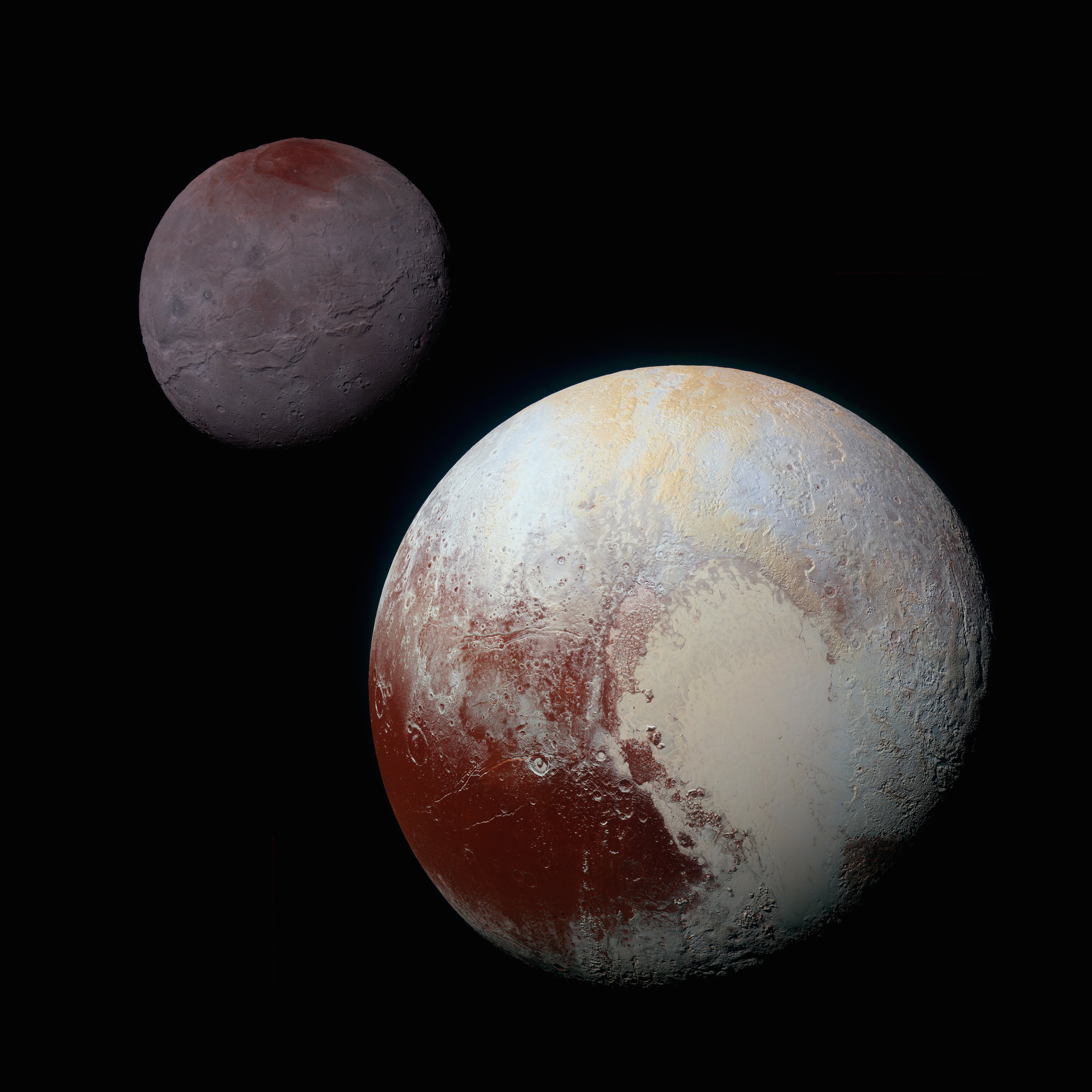 This composite of enhanced color images of Pluto (lower right) and Charon (upper left), was taken by NASA's New Horizons spacecraft as it passed through the Pluto system on July 14, 2015. This image highlights the striking differences between Pluto and Charon. The color and brightness of both Pluto and Charon have been processed identically to allow direct comparison of their surface properties, and to highlight the similarity between Charon's polar red terrain and Pluto's equatorial red terrain. Pluto and Charon are shown with approximately correct relative sizes, but their true separation is not to scale. The image combines blue, red and infrared images taken by the spacecraft's Ralph/Multispectral Visual Imaging Camera (MVIC).  Credit: NASA/JHUAPL/SwRI