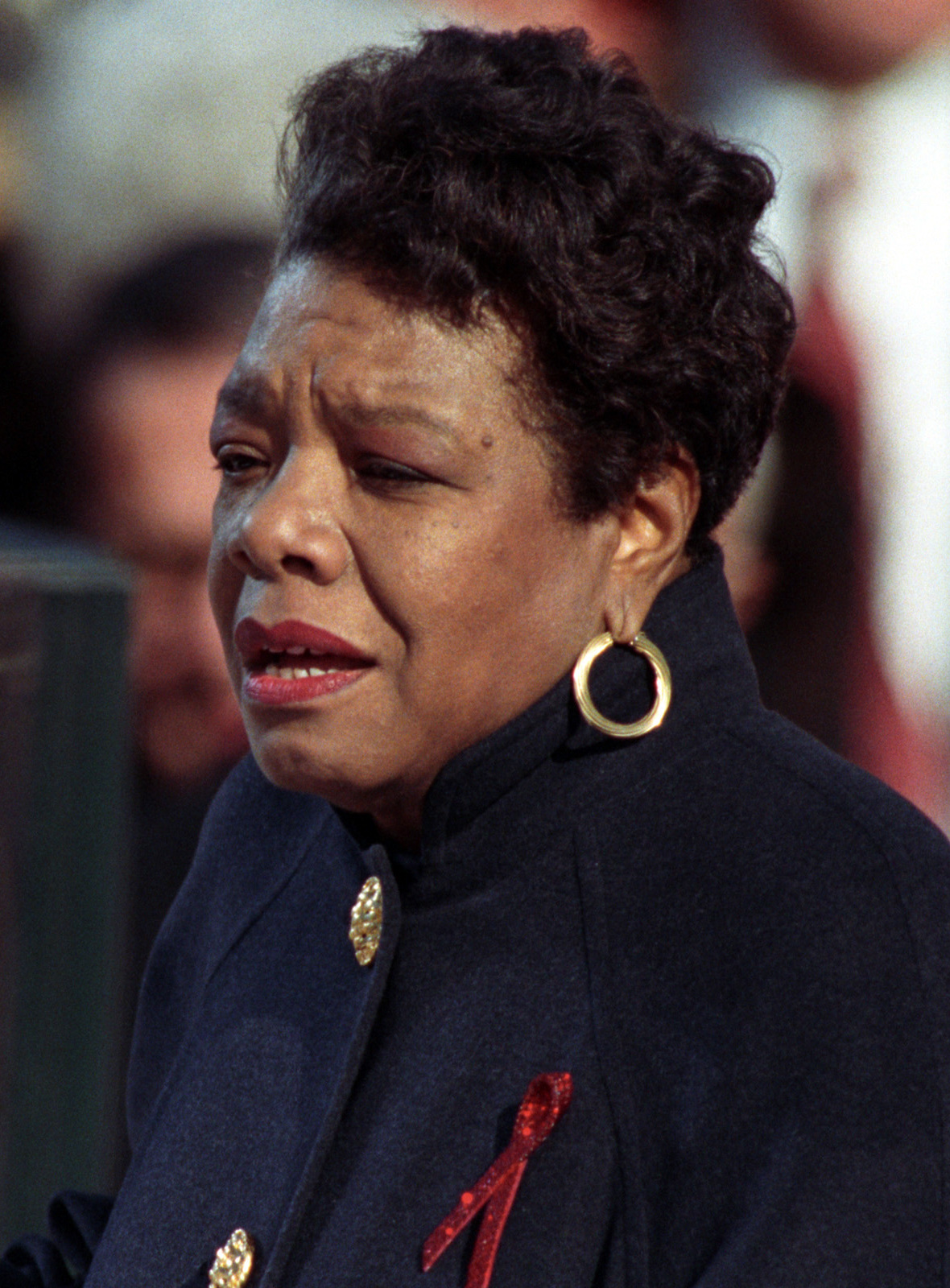"""Angelou reciting her poem """"On the Pulse of Morning"""" at President Bill Clinton's inauguration, January 20, 1993 By Clinton Library - William J. Clinton Presidential Library, Public Domain, https://commons.wikimedia.org/w/index.php?curid=67072902"""