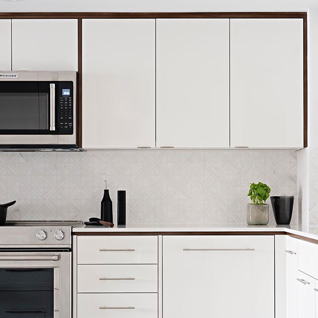 I spy herbs in this custom SBD condo kitchen #sarabedermandesign #spring #kitchendesign #condoliving #designer #details #white #walnut #wood #marble #custom #renovation #create #design #kitchendecor #homestyle #modern #LoveYourHome