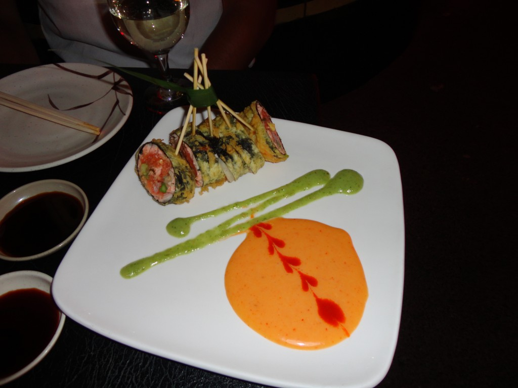 Sushiya Signature Roll: Salmon, spicy tuna, crab, avocado, asparagus, ginger, with a hint of mashed potatoes (yes, potatoes!) wrapped in seaweed, tempura fried, with spicy cilantro cream sauce.
