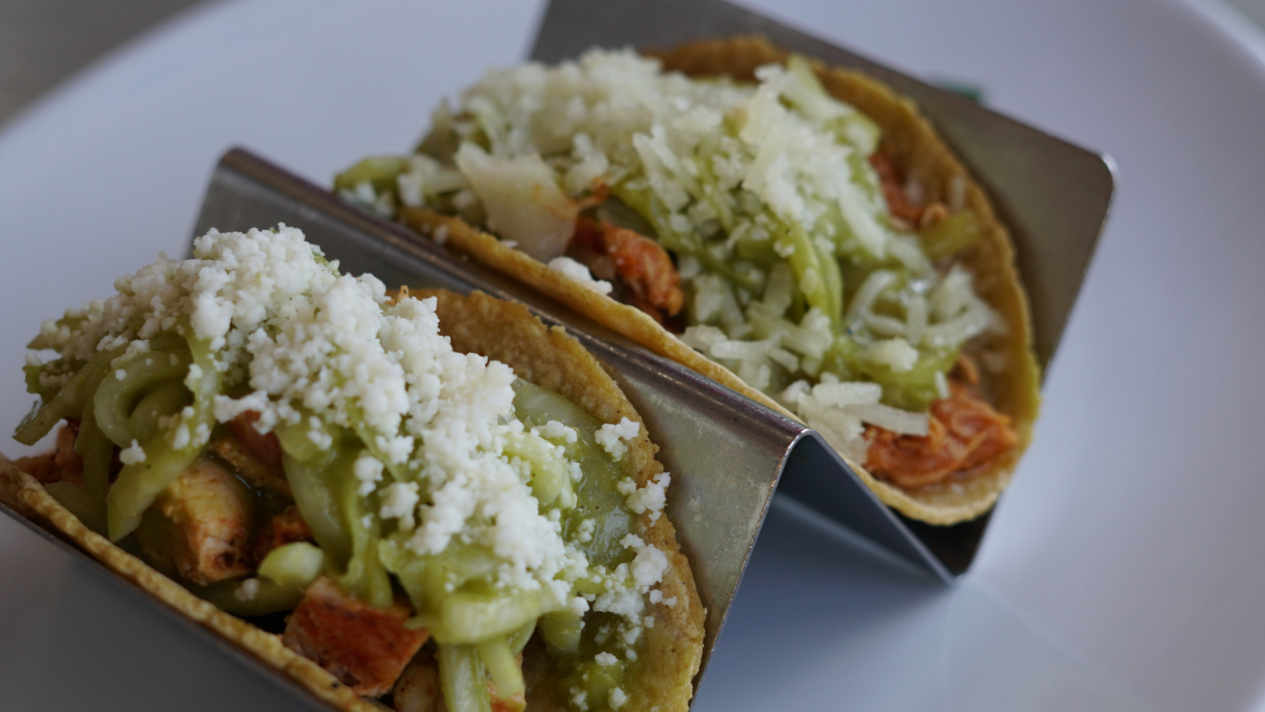 From left: chicken taco and chicken tinga taco, cali green style