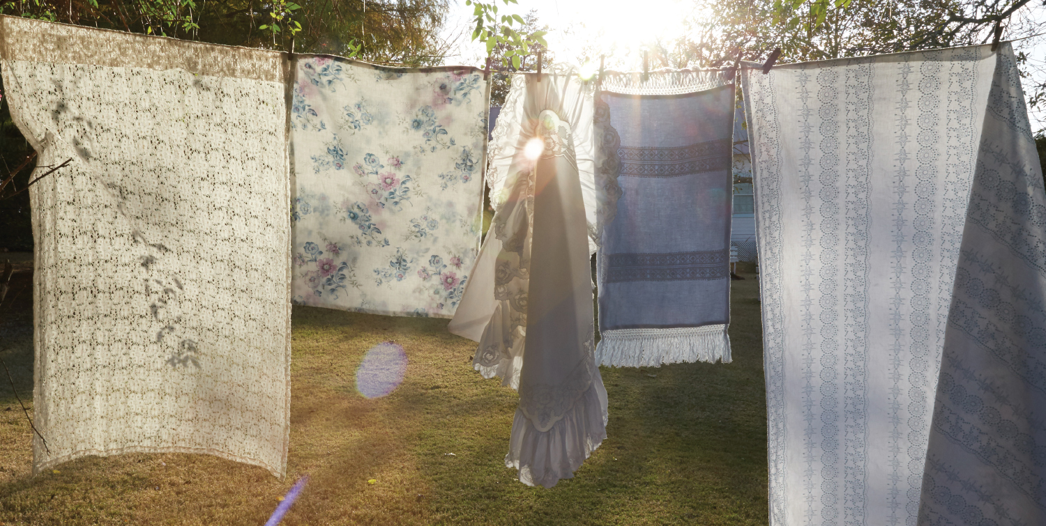 The core of Ashwell's offerings has always been her design of slipcovered furniture and bed linens, layering in the one-of-a-kind vintage treasures. Photos by Amy Neunsinger and Sarah Pankow