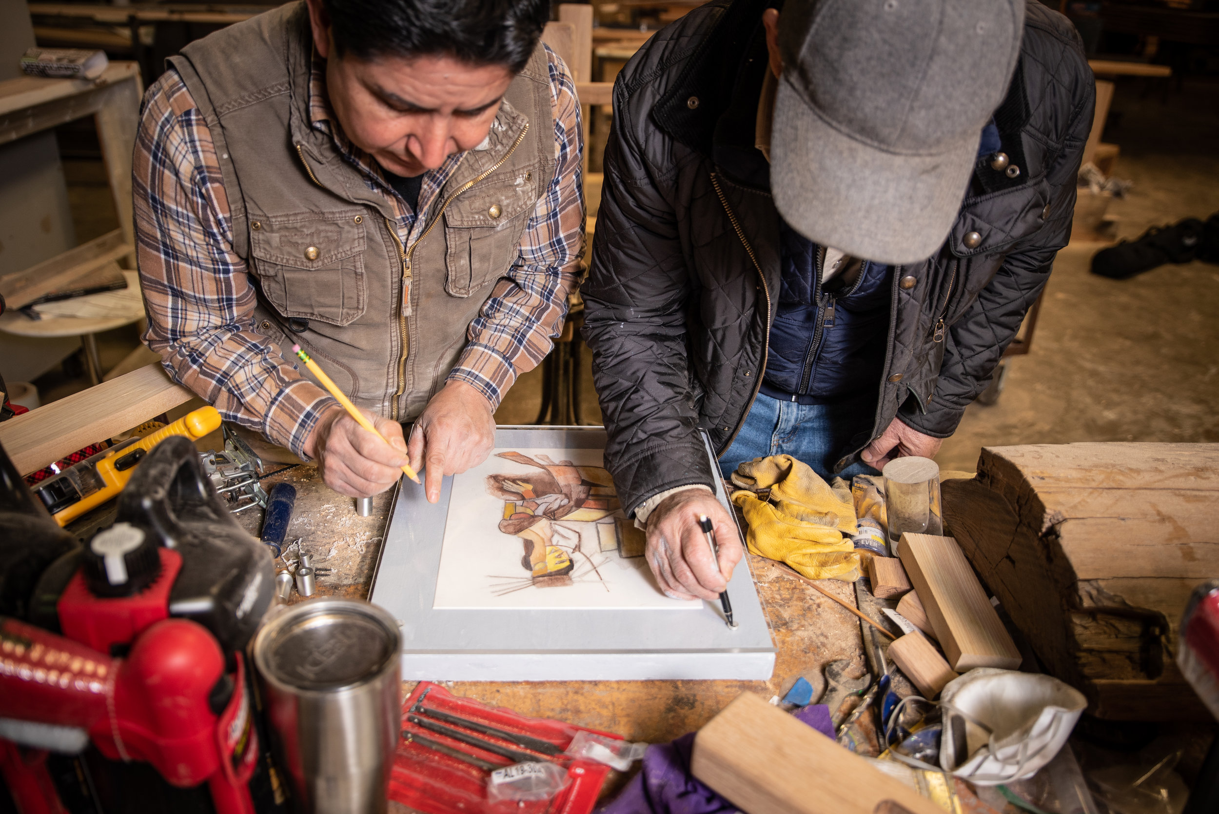 Paul and Salvador create a frame from an original piece of art. Photo by Ashlee Nobel