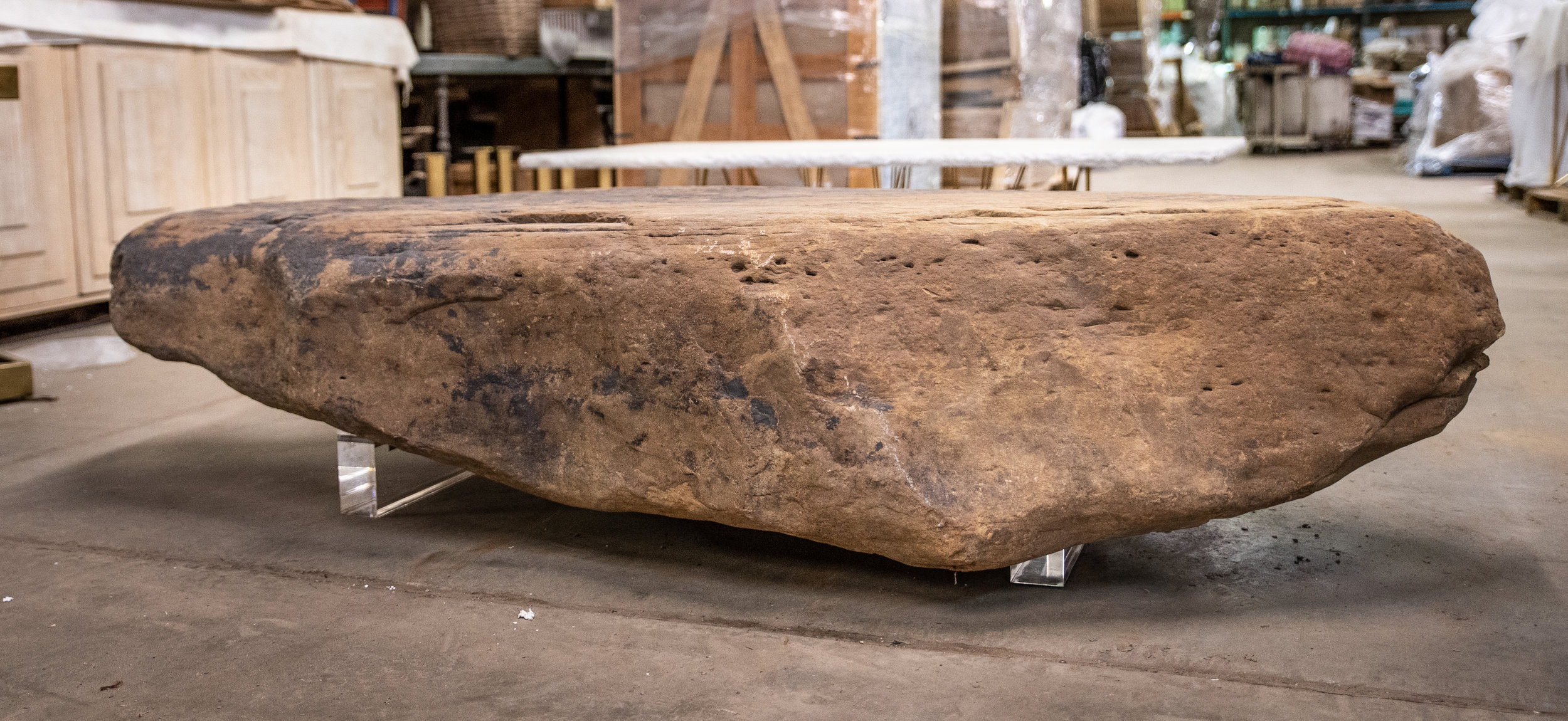 Boulder coffee table by the Paul Michael Company. Boulder harvested from Northwest Arkansas. Photo by Ashlee Nobel