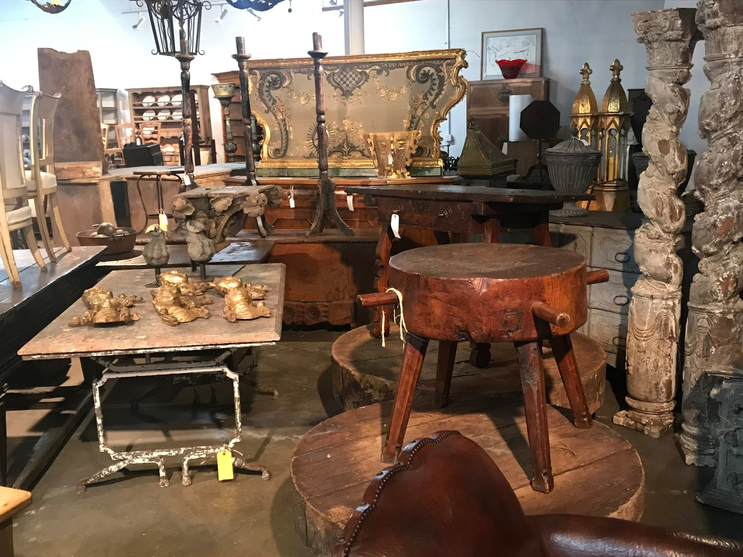 17th century Portuguese Solomonic columns, 18th century wine presses from Provence now as coffee tables, an 18th century Italian stump work embroidery altar facade, a 19th century marble top garden table from Provence and more. Photos courtesy of Provenance Antiques.