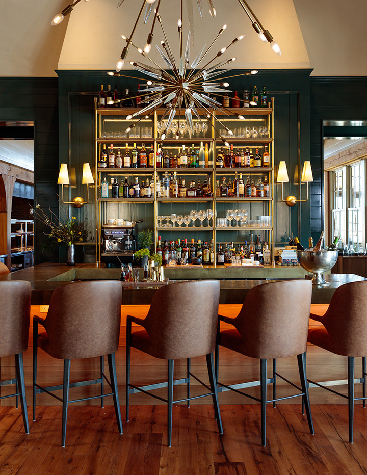 Photo by The Ingalls  Whipperwill Bar at Blackberry Mountain Lodge. With Quintus barstools from Dennis Miller, sconces from 1stdibs, and chandelier from Round Top.