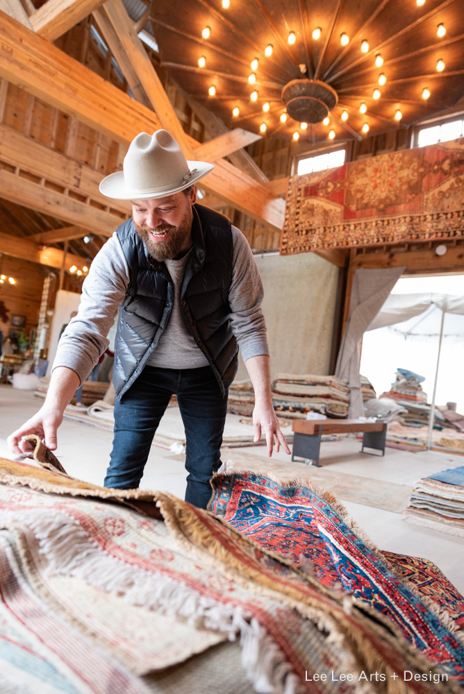 For his Austin client, Phillip was searching high and low for the best antique rugs. He ultimately found the antique rugs he was hoping for at Nomadic Trading Company at Market Hill.  Photo by Ashlee Nobel, Lee Lee Arts + Design