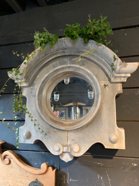 French 18th-century zinc oeil de boeuf windows with mirrors  Photo by Architect's Daughter