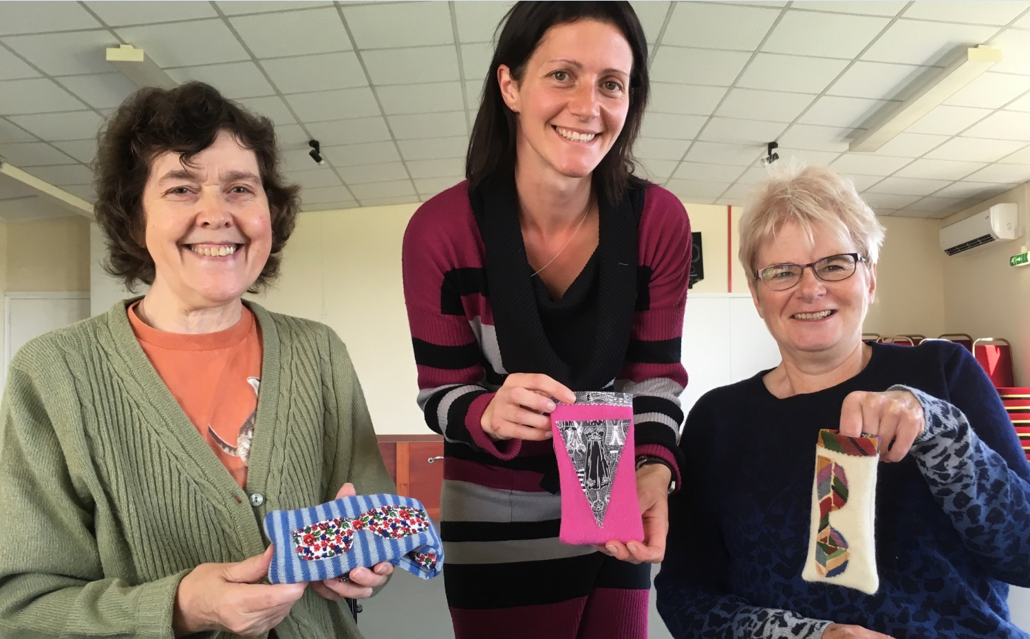 Workshop participants show off their creations in Necton