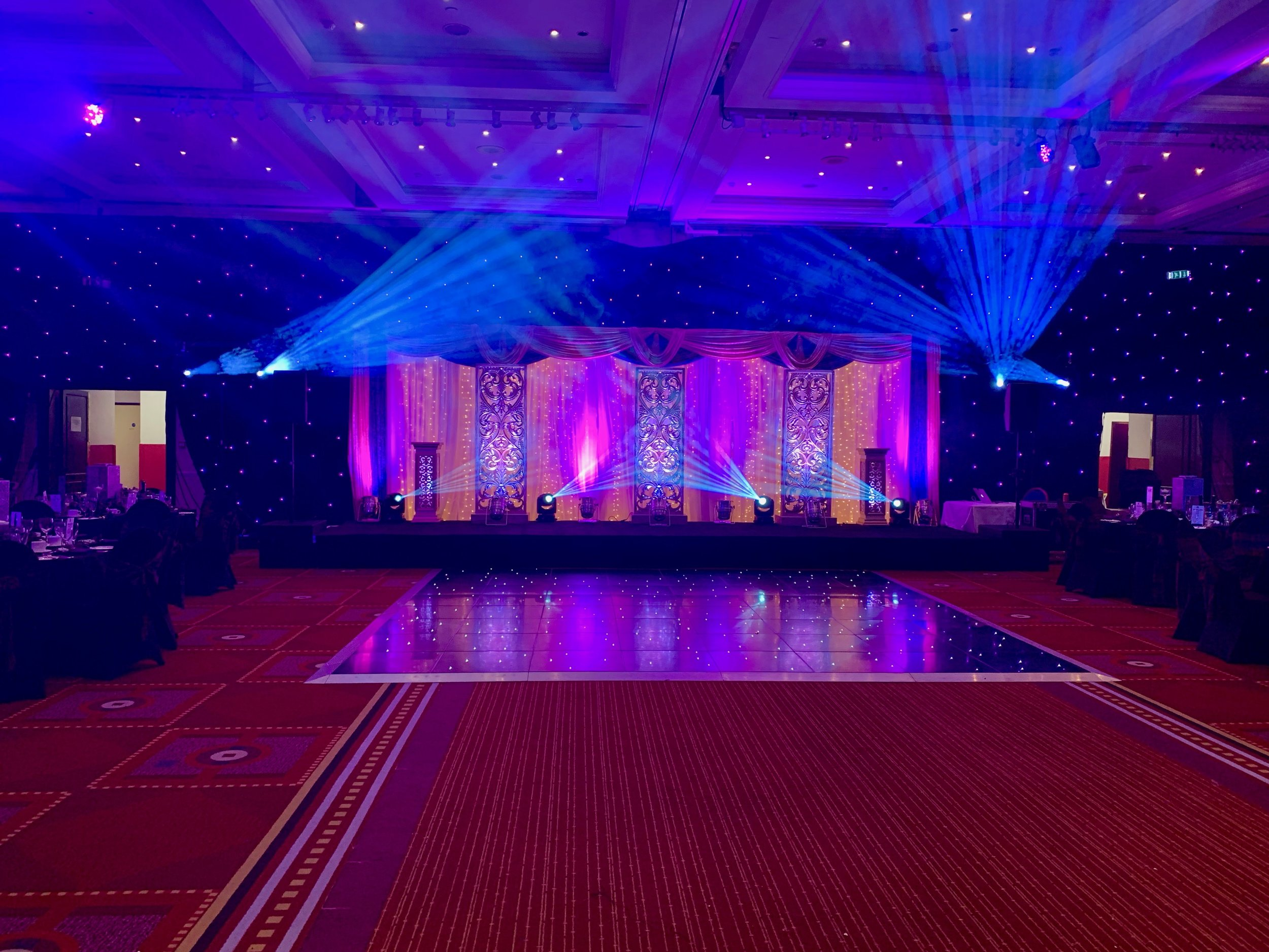 This was a large setup for a DJ at the Glasgow Marriott Hotel. Note how you can barely see the design of the speakers at each side of the stage, they just blend in!