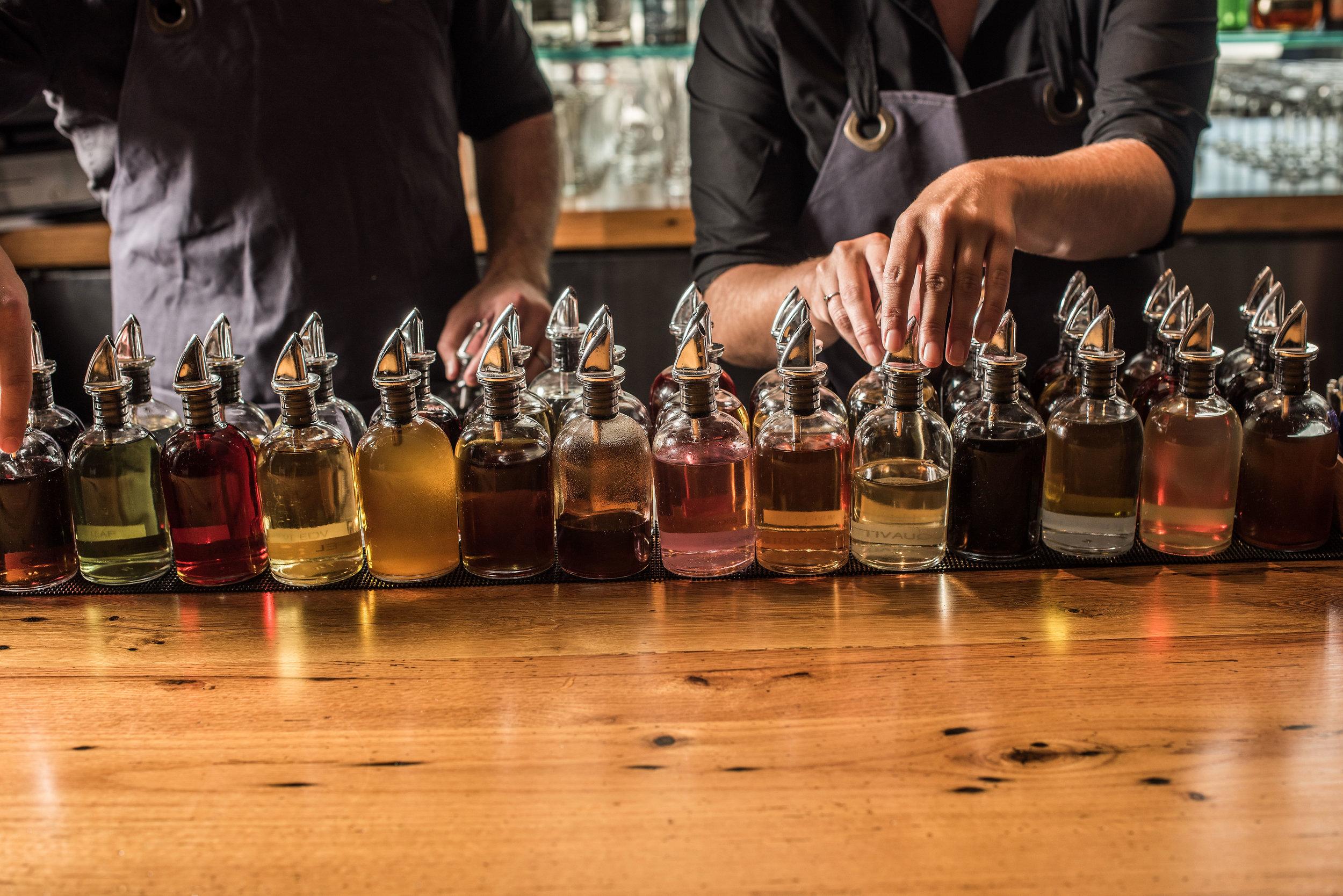 greenriver-bar-detail-bottles and bartenders-anthony tahlier-lg.jpg