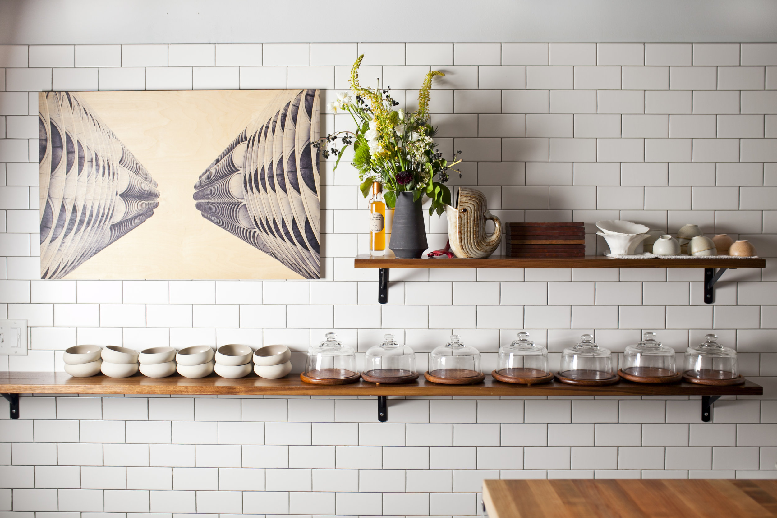 Photo: Sammy Faze Photography   The bright, white tile of Oriole's open kitchen.