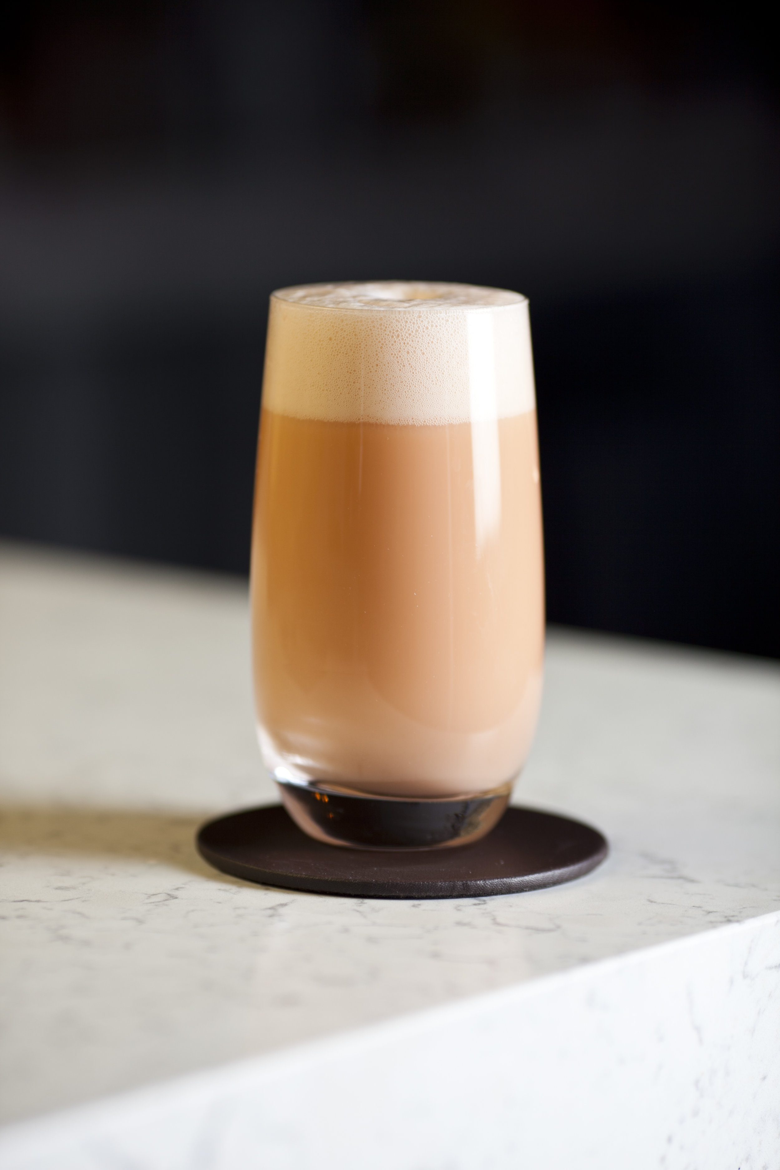 Settle back and enjoy your frothy Aperol Egg Cream cocktail.