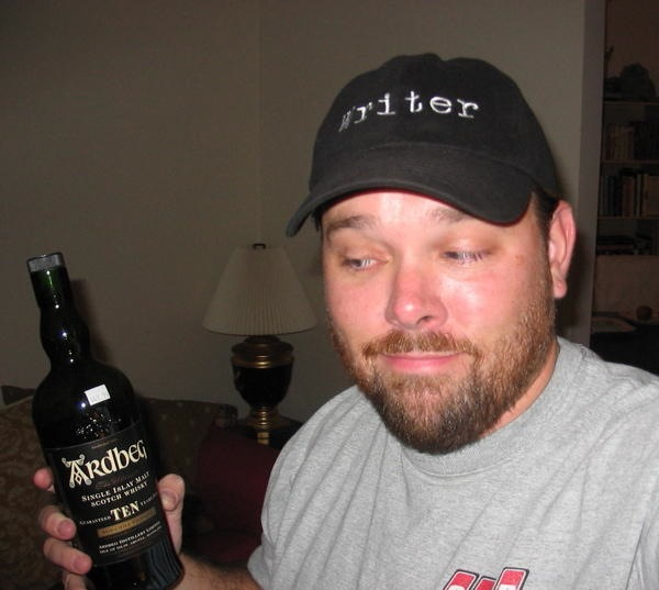 With a snappy cap and a bottle of Scotch, you, too can be a screenwriter! 2004,Los Angeles, CA