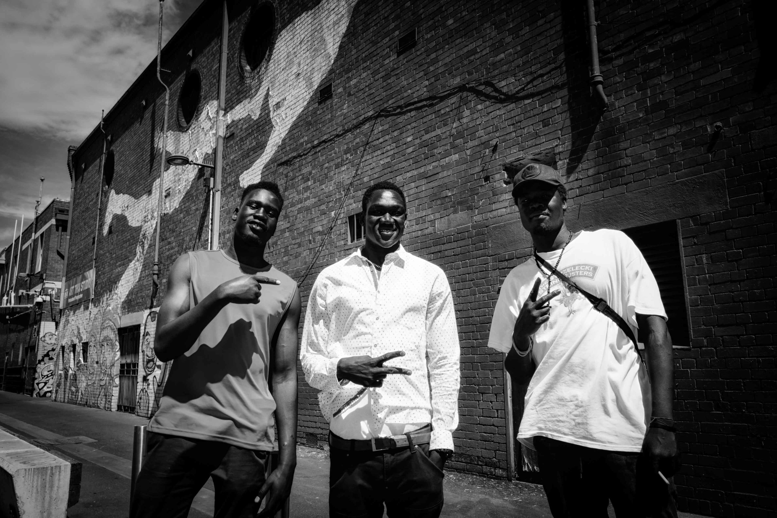 In this image is 29-year-old Torit Chol Bol (centre) with his friends Jay and Pablo. Chol Bol hopes for compassion, unity and equality in the world. 'What makes us human is what we feel in our hearts. When we see a homeless person, it is what is in our hearts, and our compassion that makes us go and help that person. We see people as people, and it is not based on the colour of their skin.'  Chol Bol told me about his experiences in jail, and how his time there have changed his life. Currently working in construction, he works hard to find his feet, helping his mum and his younger sisters, and in guiding other youth in the area. 'Many young people here, they don't have a father figure to guide them. I lost my father back in South Sudan - he died in the war. So nowadays, I look out for the young ones on the streets and I try to be a positive influence for them.'  Through chatting and having a stroll with him through his neighbourhood, his resilience and his compassion really shines through. Seemingly stoic on the outside, he speaks with incredible warmth and honesty. 'I really love to express myself through music,' he says, 'I'm going to title my next album 'unbroken'. When you have been where I am, people try to break you. I must remain strong, and not let that happen'.