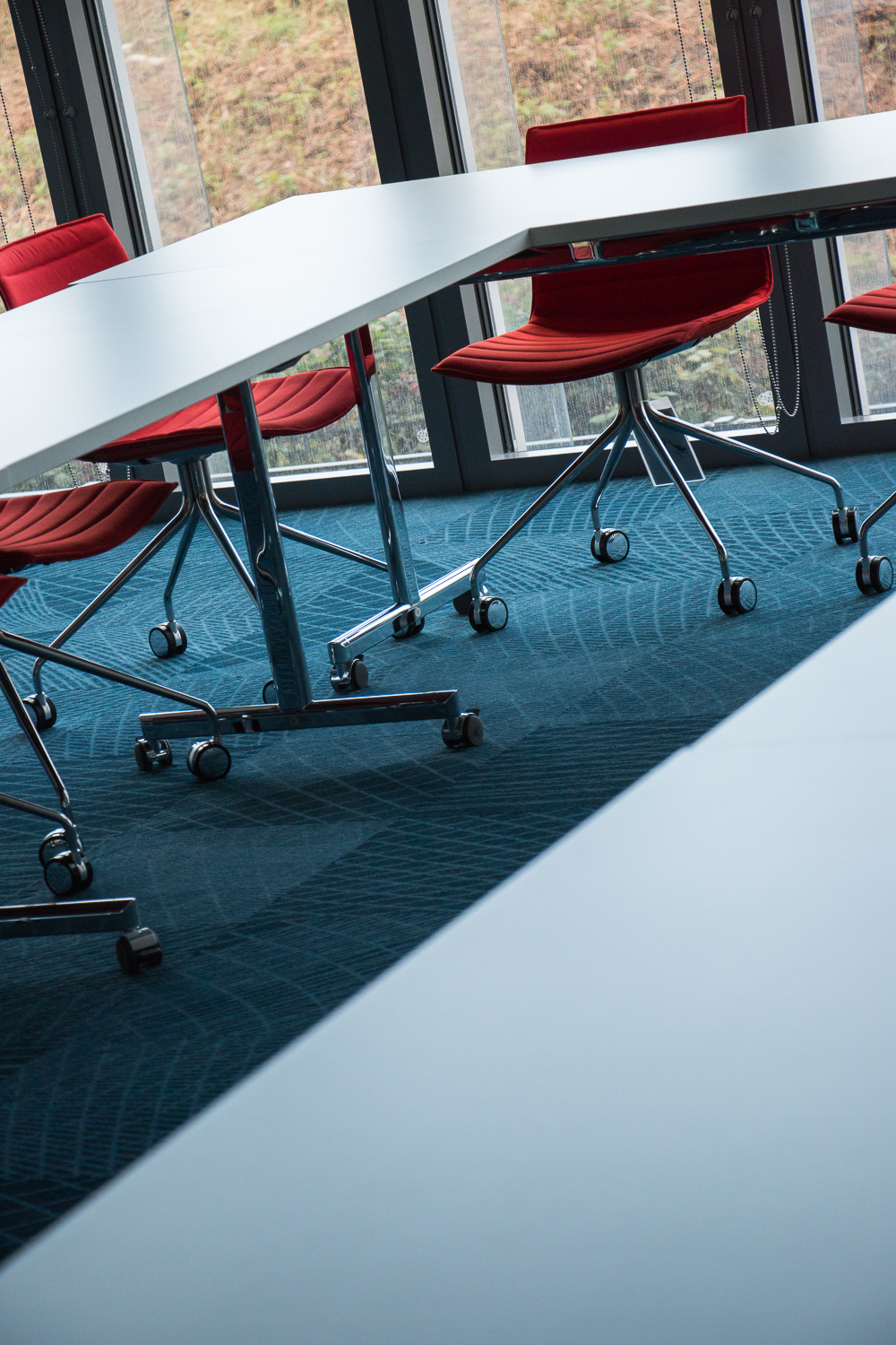 A close-up of chairs and tables in a horseshoe shape in a meeting room at the Imperial White City Incubator